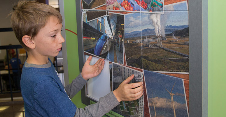 A child looks at an exhibit at the NCAR Mesa Lab in Boulder