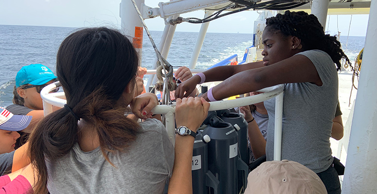 REU students working aboard a research vessel.