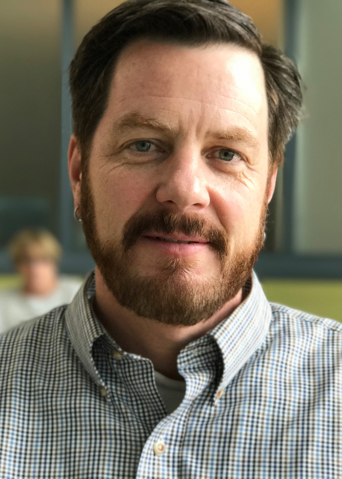 Headshot of NCAR scientist Michael Mills