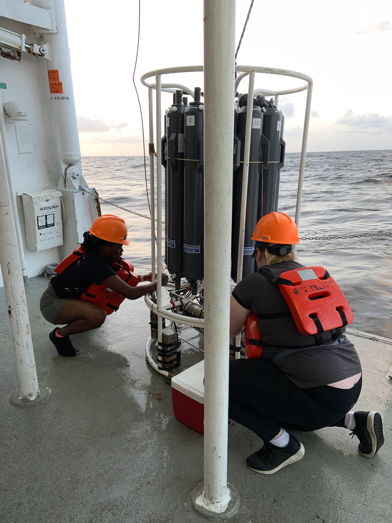 REU students work on a ship