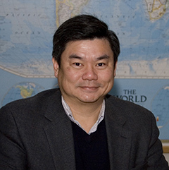 Image of Wen-Chau with an image of the world map in the background.