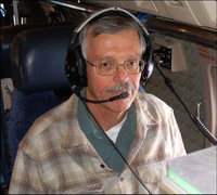Principal investigator David J. Raymond with headset in an aircraft