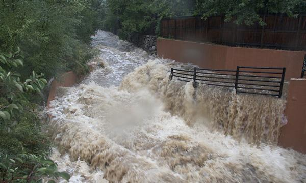 Boulder Creek floods onto nearby bike paths, as an example of graceful failure