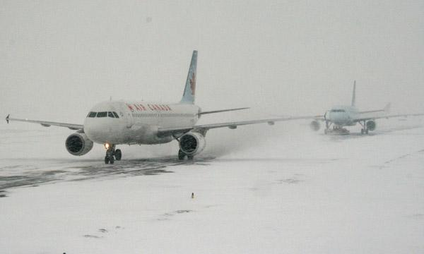Airplanes on a snowy runway