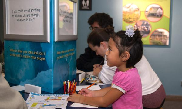 A child participates in one of the exhibits at the NCAR Mesa Lab