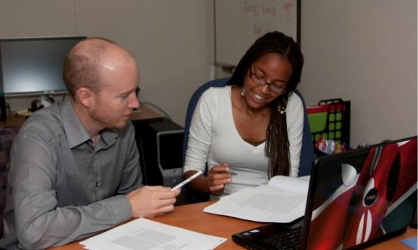An REU student working with their mentor