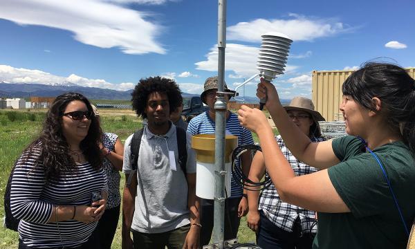 Students at NCAR install atmospheric instrumentation