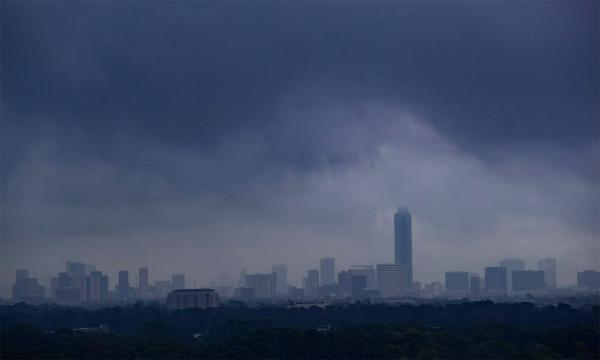 A storm forms over the skyline of Houston