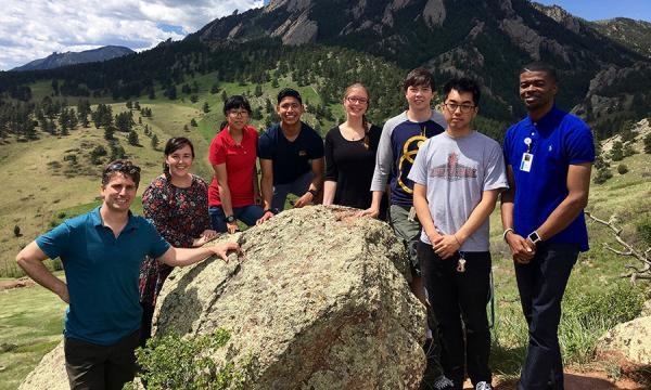 Group photo of interns in front of the Boulder Flatirons