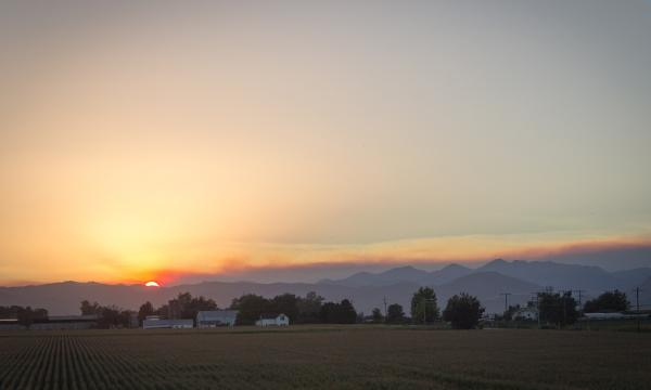 A sunset over a smoky horizon due to a wildfire